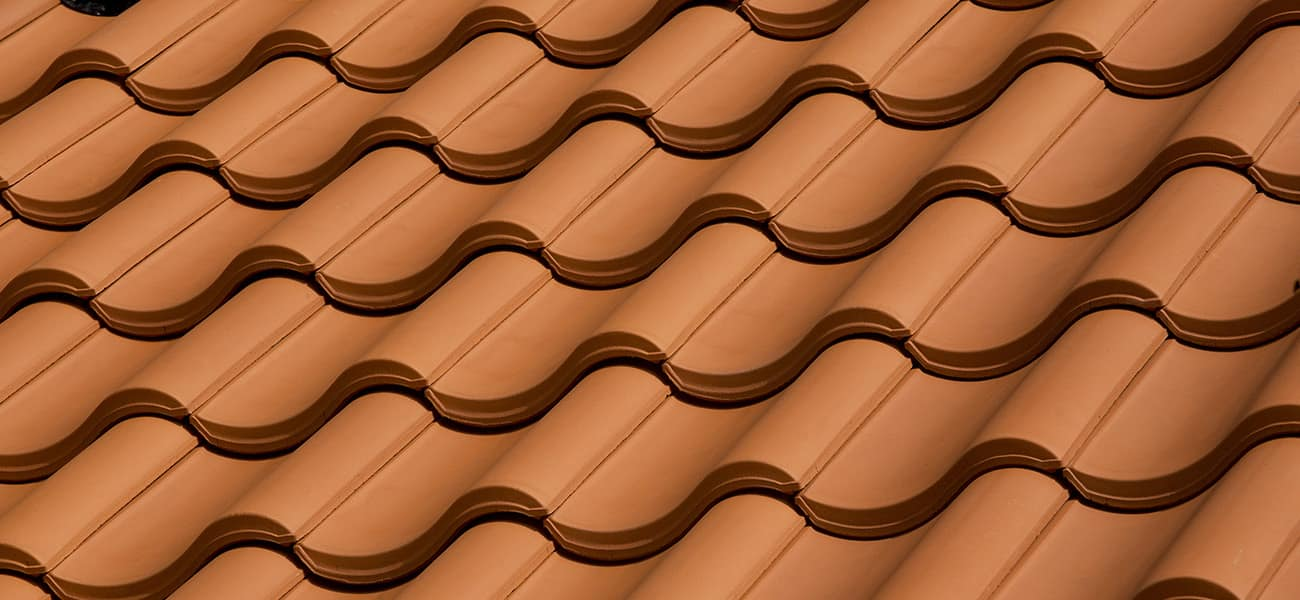 Single interlocking pantile natural red used on a low pitch roof