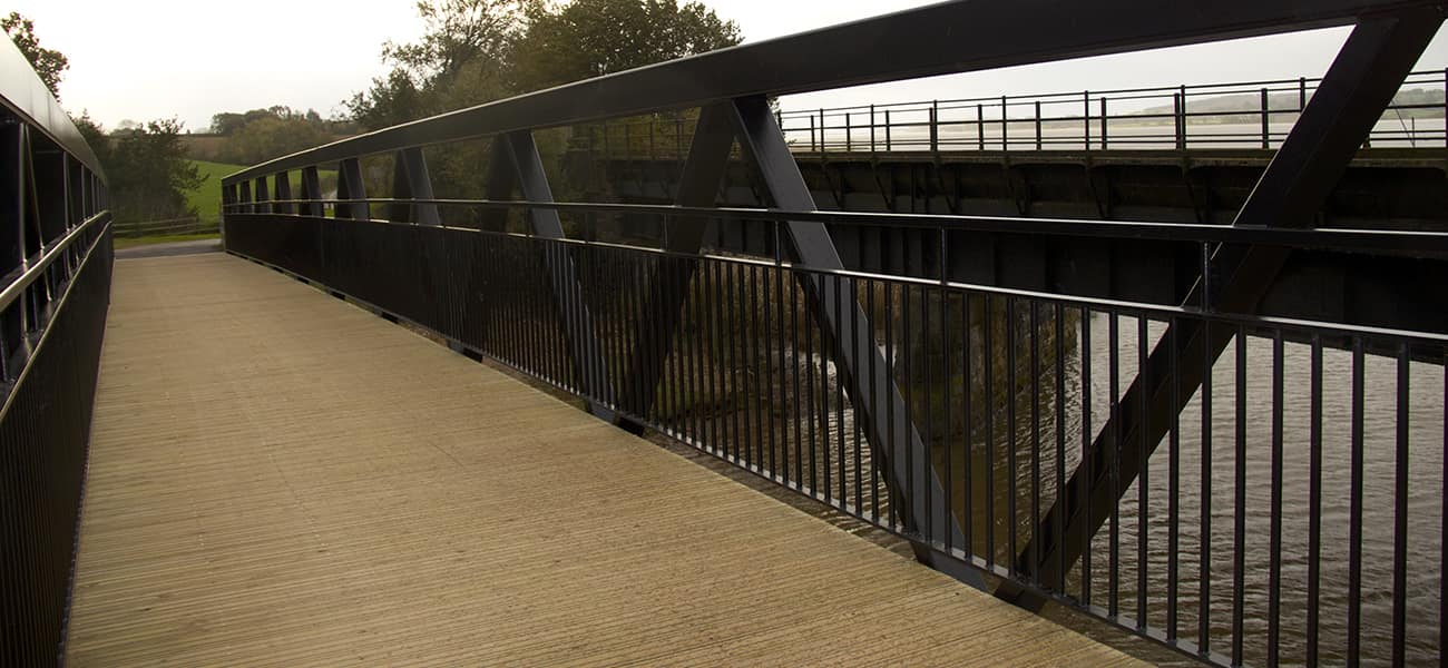 Timber decking use on a pedestrian bridge over the river