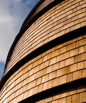An image of Marley Western Red Cedar Shingles in place on a large, curved building.