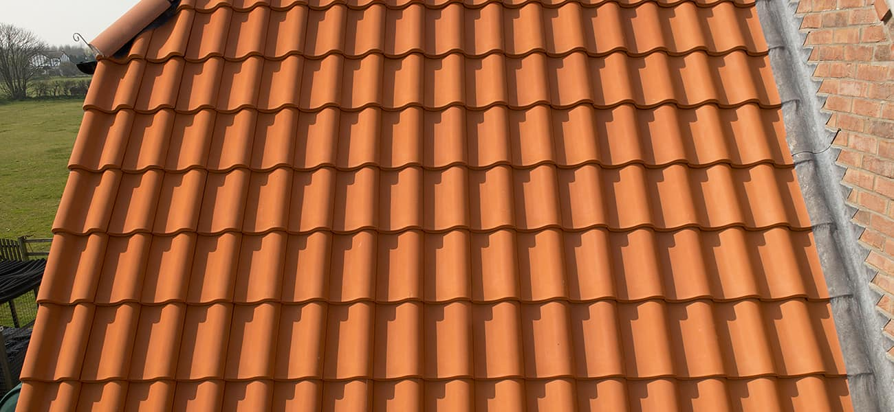 Rose Cottage close up of Melodie Natural Red Clay interlocking tile