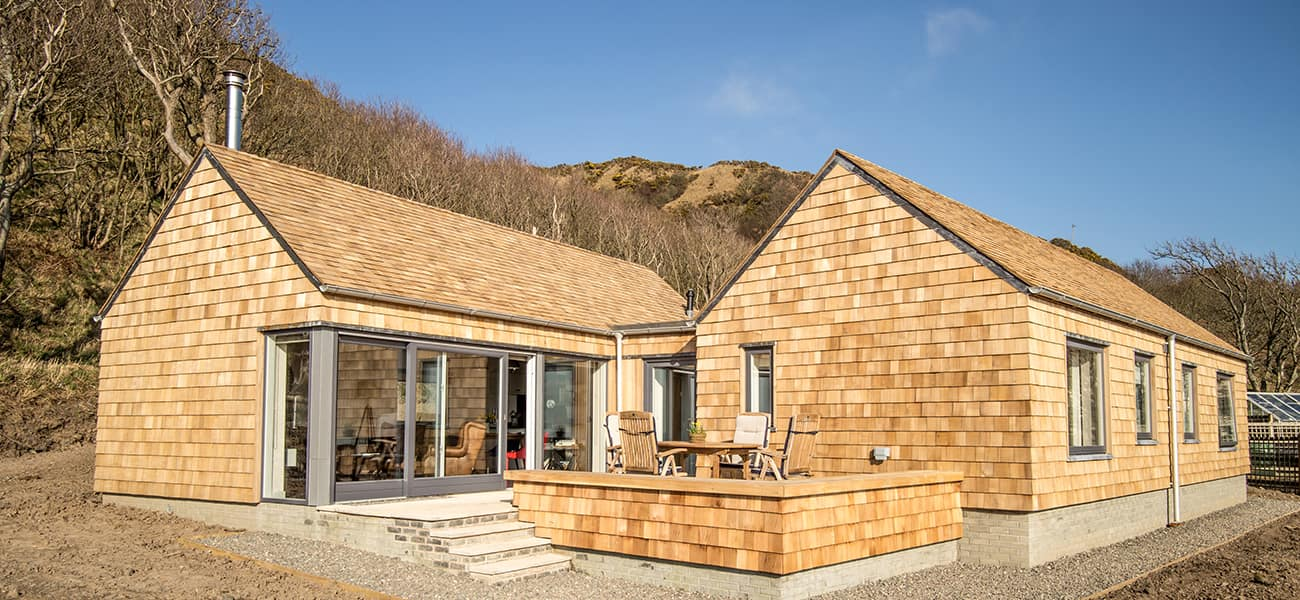 two house built entirely with timber shingles