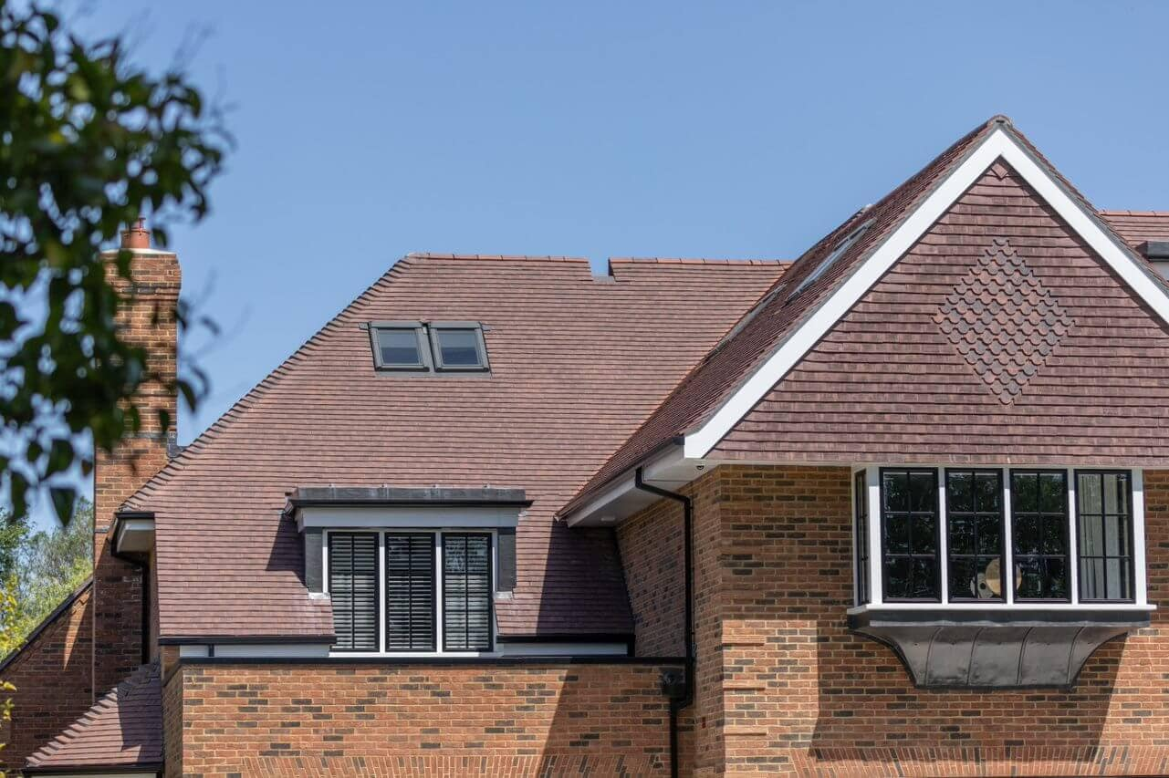 Close up on a residential house featuring Marley's Acme Double Camber clay plain tile