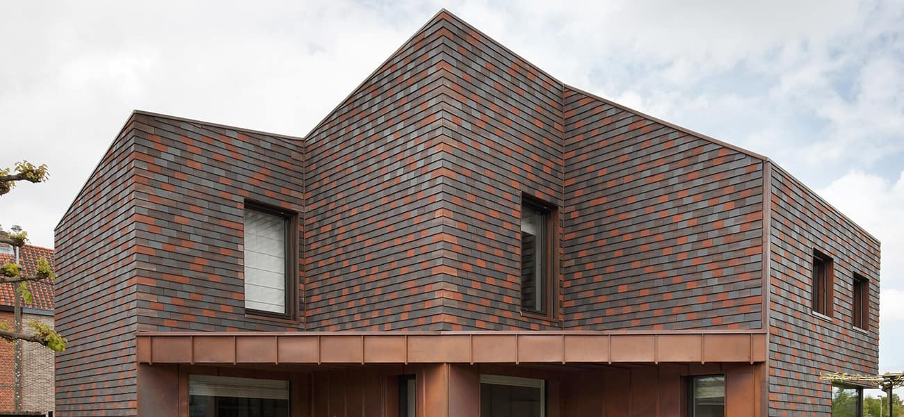 Panoramic view of Hawkins Single Camber Clay Plain Tiles from Marley to give character to the minimalist design.