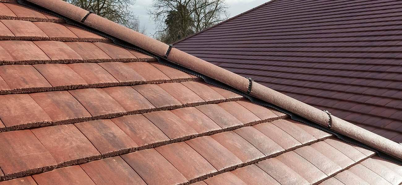 A close up image of Ashmore Interlocking Double Plain Tile in situ on a pitched roof.